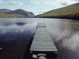 A Scenic View of a Dock on a Lake