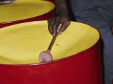 An Island Musician Plays a Brightly Colored Set of Steel Drums