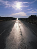 The Sun Reflects on This Black Tarred Road in Arizona