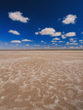 A Vivid Blue Sky Above Sand and Shallow Water