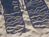 Shadows of Lounge Chairs on Beach Sand