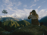 Woman with Binoculars Near the Annapurna Range  Nepal