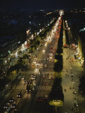 An Elevated View of a Traffic-Filled Paris Street at Night