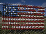 A Makeshift American Flag of Plastic Cups Decorates a Fence