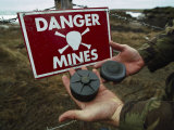 Deactivated Mines Held by a British Explosives Expert