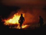 Firefighters Start a Controlled Fire on Prairie Land at Night