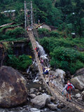 People Crossing Sagging Suspension Bridge Over Khudi Khola on Annapurna Circuit  Nepal