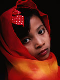 A Portrait of a Muslim Girl with Her Face Framed by a Colourful Scarf  Indonesia
