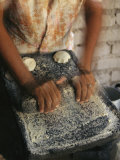 A Cora Woman Grinds Corn for Tortillas