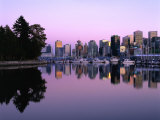 City Skyline at Dusk Reflected in Coal Harbour Vancouver  British Columbia  Canada