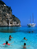 Tourists Swimming in Waters of Cala Mariolu in Gulf of Orosei  Sardinia  Italy