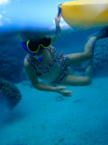 Girl Snorkelling While Holding onto Canoe  Cook Islands