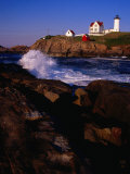 Surf Crashing on York Beach with Nubble Lighthouse in Background  Cape Neddick  USA