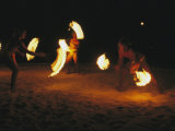 Polynesian Dancers Put on a Traditional Fire Dance Performance