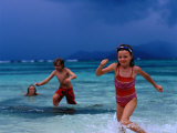 Children Running Out of Ocean in Stormy Weather  Seychelles