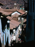 Steep and Narrow Hatunrumiyoc Street  with La Merced Tower in Distance  Cuzco  Peru
