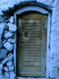 Wooden Door in Rubblestone Wall  Kalymnos  Greece