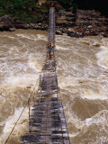 People Crossing Suspension Bridge Over Rapids of Ballem River  Bailum Gorge  Irian Jaya  Indonesia