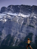 Woman Running in Front of Mountain  Banff  Canada