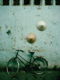 Conical Hats Hang on Wall Above Bicycle in Historic Old Quarter  Hanoi  Vietnam