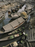 Houseboats Line a Waterway Through a Poor Kashmir Town