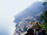 Couple Reading Guidebook on Lookout Above Town  Positano  Italy