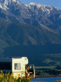 Woman Reading Map in Campervan with Mountain Behind  Kaikoura  New Zealand