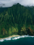 Aerial View of a Beach at the Base of a Lush South Pacific Mountain