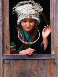 Shidong Miao Girl Wearing Silver Head Dress Looking Through a Window  Kaili  China