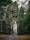 Visitors Enter the Angkor Wat Complex Through a Magnificent Gate