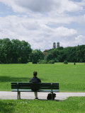 Man Sits in the English Garden in Munich