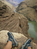 Feet Shod in River Shoes on an Overlook above the Colorado River