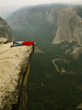 Prone Man Peers over Taft Point into the Yosemite Valley