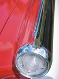 Sleek Tail Light on Antique Red Car