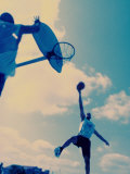 Low Angle View of Two Men Playing Basketball