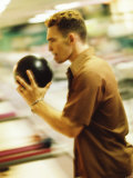 Side Profile of a Young Man Holding a Bowling Ball