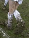 A Soccer Player's Muddy Cleats