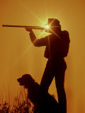 Silhouetted Hunter with Dog