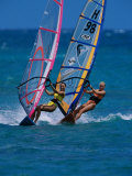 Portrait of Two Young Women Windsurfing