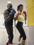 Young Male Coach Coaching a Female Boxer
