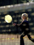 Blurry Image of a Girl Playing Tennis