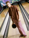 Young Man Standing at a Bowling Alley