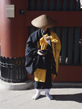 Buddhist Monk Collecting Alms and Praying  Asakusa Kannon Temple  Tokyo  Honshu  Japan