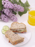 Elegant Sandwich and Juice with Blooming Purple Flowers