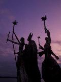 Slender Statues on Coastline at Dusk  Puerto Rico