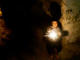 A Palestinian Boy Holds a Sparkler after Breaking the Fast on the First Day of Ramadan in Gaza City