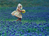 A Girl  3  Goes for a Romp Through a Field of Bluebonnets