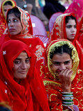 Two Pakistani Brides  Smile During a Mass Wedding Ceremon
