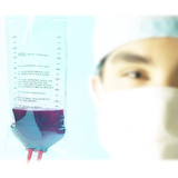 Doctor's Face Next to Blood Transfusion