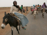 Sudanese Women Ride Donkeys at the Entrance of the Zamzam Refugee Camp